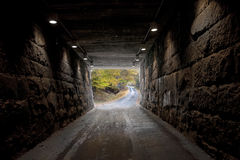 Narrow road tunnel Royalty Free Stock Photo