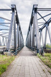 Narrow road between two Truss Bridges Royalty Free Stock Photos