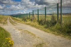 Narrow roadway running along Carrickfinn airport Co. Donegal.  royalty free stock image
