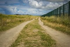 Narrow roadway running along Carrickfinn airport Co. Donegal.  stock photos