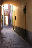 Narrow romantic alley in Noli, Italian Riviera. The Italian village of Noli, situated on the Western part of the Ligurian Riviera, is a traditionally important Royalty Free Stock Photos