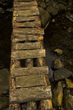 Narrow and ruined small wooden bridge at Black river gorge Royalty Free Stock Photography