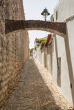 Narrow rusty street Stock Images