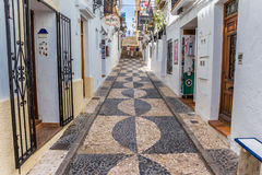 Narrow shopping street in the center of Altea Stock Photos