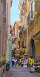 Narrow Shopping Street, Sorrento Italy. A narrow, colorful twisting street lined with shops selling local souvenirs and people in the old town area of Sorrento Stock Images
