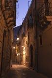 Narrow Sicilian street. Illuminated at night Stock Photography
