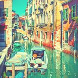 Side canal with moored motorboats in Venice Royalty Free Stock Images