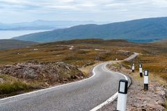 A narrow single-track road Western Highlands - Scotland, UK. A narrow single-track road in the remote Western Highlands - Scotland, UK Stock Photo