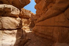 Narrow slot between two rocks in desert canyon Stock Photos