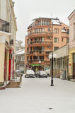 The narrow snow-covered street in Pomorie, Bulgaria stock photos
