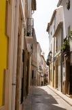 Narrow Spanish street stock photos