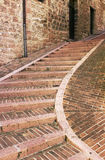 Narrow staircase street of the old town of Assisi, Italy Stock Photos
