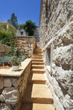 Narrow staircase in traditional mediterranean home. Flom garden to other terrase Royalty Free Stock Images