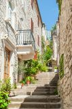 Narrow stairs alley. Old masonry buildings. Hvar, Croatia. One of many lovely little stairs alley in old town stock images