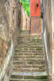 Narrow stairway in Bosa, Italy Royalty Free Stock Photos