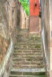Narrow stairway in Bosa, Italy Royalty Free Stock Photos