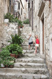 Narrow stairway in the old city, Dubrovnik. Two kids stonds with ice cream at summer holiday, in Croatia Royalty Free Stock Image