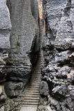 Narrow stairway in SShilin stone forest, world-famous natural karst area, China. Narrow stairway in Shilin stone forest, world-famous natural area of limestone stock photo