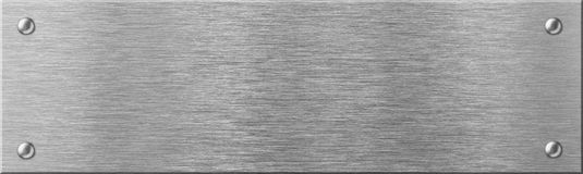 Narrow steel metal plate with rivets stock photo