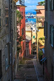 Narrow steep alley in the city center of Genoa Royalty Free Stock Photo