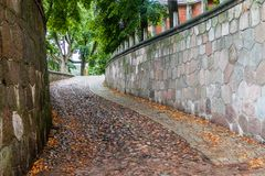 Narrow steep cobbled alley in Kaunas, Lithuan. Ia stock images