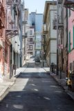 Narrow steep street in San Francisco with clean sidewalks and fire escapes. Narrow steep street in San Francisco with clean sidewalks and old fire escapes royalty free stock image