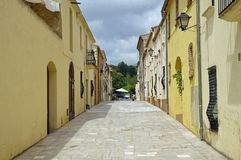 Narrow steep street in small village located in the Park of Serra de Montsant, Spain stock photos
