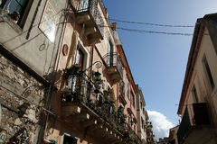 Narrow steets and historic buildings in Taormina Stock Image