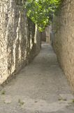 Narrow stone alley Stock Photography