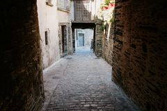 Narrow stone medieval street in Vitre old town. Travel to France - narrow stone medieval street in Vitre old town in Ille-et-Vilaine department of Brittany in Stock Image
