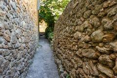 The narrow stone passage. Narrow stone walkway in Pals, Spain stock photography