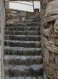 Narrow stone staircase of old cobblestone up into the unknown stock image