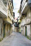 Narrow stone street in Custa with very old buildings in a typica. L village of the Atlantic coast of La Coruna, Spain. Call Pontedeume Royalty Free Stock Image