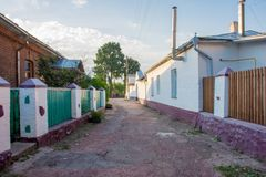Narrow stone streets with green fences and white pillars and walls in the small historic old town of Ovruch, Zhytomyr region, Ukra. Ine, the former capital of Royalty Free Stock Photos