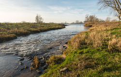 Free Narrow Stream Flows Into A Large River Royalty Free Stock Photography - 64361717