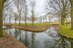 Narrow streams in a Dutch park in autumnal colors Royalty Free Stock Image