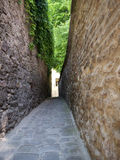 Narrow street. With stone wals on both sides. For pedestrians only Stock Photos