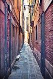 Narrow street. Narrow alley in Venice, Italy royalty free stock image