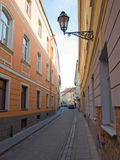 Narrow street. A narrow street in Vilnius oldtown Stock Image