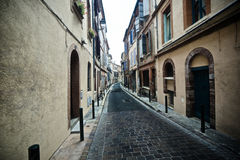 Narrow street. Wide angle view of a narrow street in Toulouse, France Stock Image