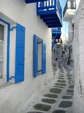 Narrow street. A narrow white-washed street in the heart of a the greek island Mykonos Stock Images