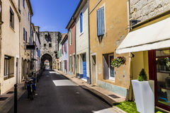 Narrow street at Aigues-Mortes Royalty Free Stock Photography