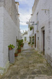Narrow street of Alberobello. Ancient district. World Heritage Site Royalty Free Stock Photo