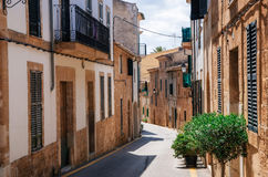 Narrow street in Alcudia, Mallorca, Spain. Mallorca, Spain. Narrow street of historical town part of Alcudia with its traditional house and architecture Royalty Free Stock Photos