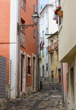 Narrow street in Alfama in Lisbon Royalty Free Stock Photo