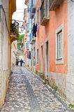 Narrow street in Alfama in Lisbon Stock Photo