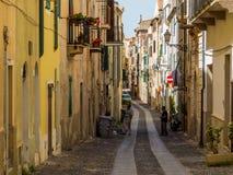 Narrow street in Alghero Royalty Free Stock Image