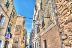 Narrow street in Alghero, Italy Royalty Free Stock Photography