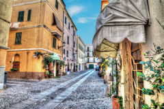 Narrow street in Alghero old town Stock Photography