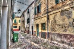 Narrow street in Alghero old town Stock Photos